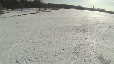 Winter, lake, ice and silhouettes of people. Landscape. Aerial — Stock Video