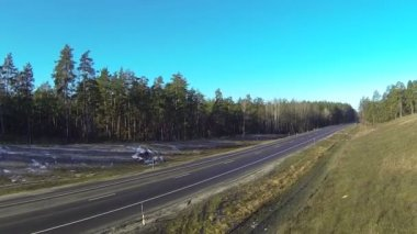 Route,  highway in wood and  sunny day. Aerial — Stock Video