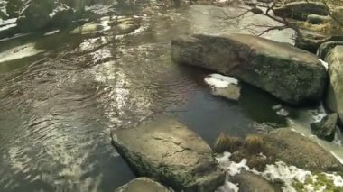 Small river cost with stones. Aerial — Stock Video
