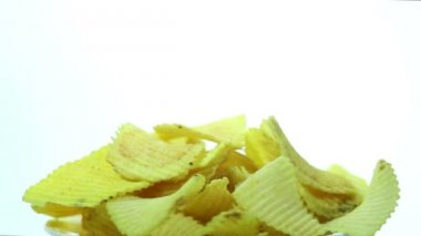 Appetizing wavy chips rotate on  white background — Stock Video