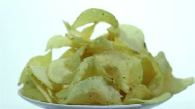 Crackle potato  chips rotate on  white plate close up — Stock Video