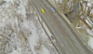 Flight along highway in  winter. Aerial view — Stock Video