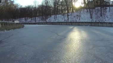 The frozen lake and sun . Aerial — Stock Video
