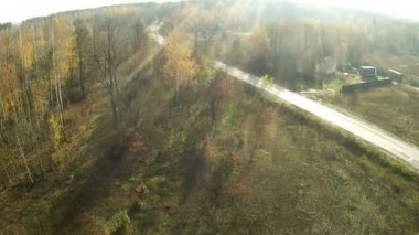 Beautiful flight in  forest district with  road. Aerial — Stock Video