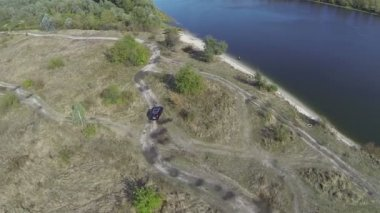 Car, jeep, in the field. Aerial shot. — Stock Video
