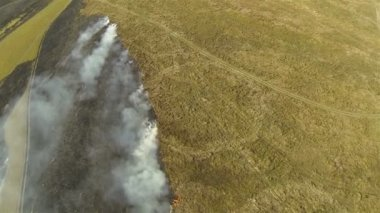 Flight over fire smoke in  steppe. Aerial shot  top view — Stock Video