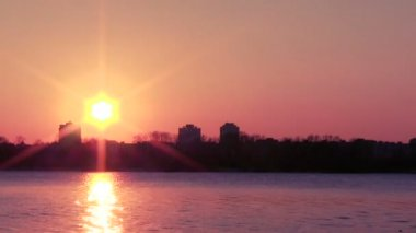 Orange sunset over river in city. PAL Time lapse — Stock Video