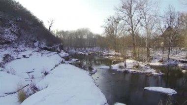Flight over a stream in  winter. Aerial — Stock Video