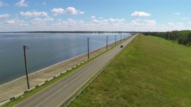 Beautiful road with car  and lake. Aerial shot — Stock Video