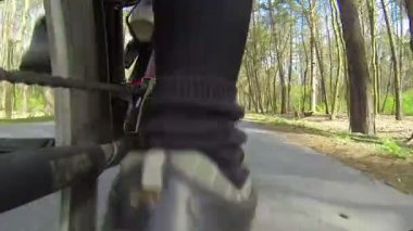Feet of  cyclist twist pedals. POV clip in spring day — 图库视频影像