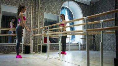 Warm-up  of girl  stripper dancer, training in  pole hall — Stock Video