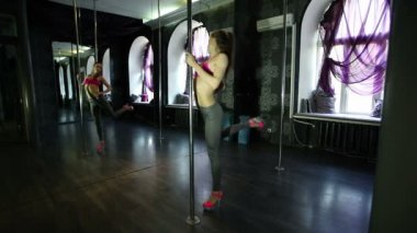 Sexual Girl dancer,  warm-up body  and training in  pole hall — Stock Video