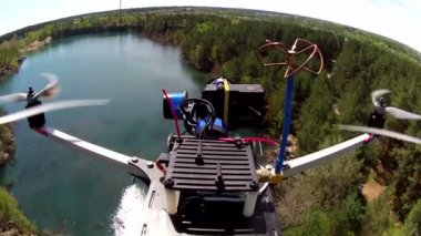 POV clip with flying over lake and wood  filming drone — Stock Video
