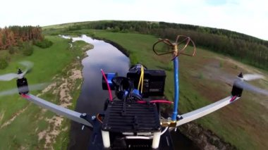 Flying drone with camera filming river and turn. POV clip — Vídeo de stock