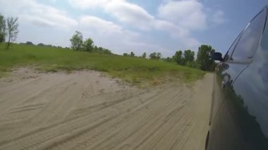 Passenger car on  road in green field . POV clip — Stock Video