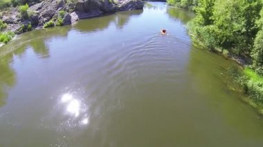 Flight over  person in  kayak on  quiet  river. Aerial top — Stock Video