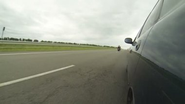 Going car is overtaken by a column of motorcyclists — Stock Video