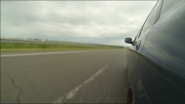 Road and car on  left side  view. Time lapse — Vídeo de stock