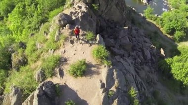 Girl  hiker tourist goes on mountain. Aerial top view — Stock Video
