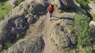 Girl  hiker tourist goes  up on mountain footpath. Aerial top — Stock Video
