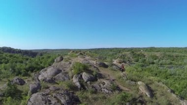 Fly over girl's  hiker silhouette on mountain . Aerial view — Stock Video