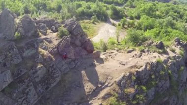 Girl  hiker  tourist walking  on mountain  top . Aerial view — Stock Video