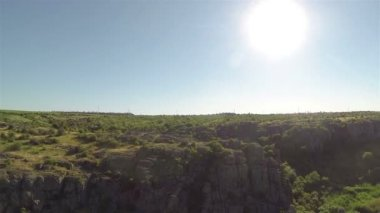 Fly over sunny canyon  with trees , river. Aerial with turn — Stock Video