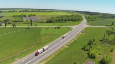 Highway in summer day with two big lorries. Aerial  panorama — Stock Video