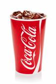 Coca-Cola with ice cubes in original cup. — Photo