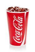 Coca-Cola with ice cubes in original cup. — Stockfoto