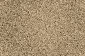 Decorative brown textured rugged plaster wall — Stock Photo