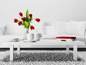 Red flowers on the  table — Stock Photo