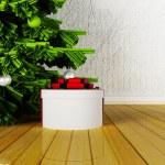 Gift near the Christmas tree — Stock Photo #59683977