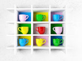 Many colored cups on the shelf,  — Stock Photo