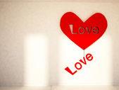 Romantic holiday decor on the wall — Stock Photo