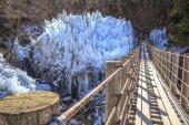 Icicle and suspension bridge — Stock Photo