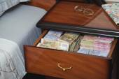 Bundles of banknotes in bedside table — Stock Photo