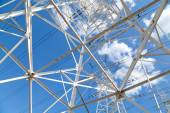 Bottom view power transmission lines against blue sky — Stock Photo