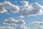 Electrical wires against blue sky and beautiful clouds — Foto de Stock