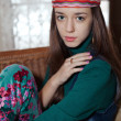 Beautiful young teenage girl hippie posing in room — Stock Photo #60758973