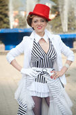 Circus artist woman in red hat — Stock Photo