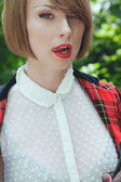 Close-up portrait of beautiful young woman in horsewoman suit in — Stock Photo