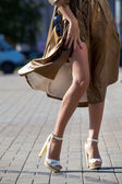 Legs of beautiful girl in high heels — Stock Photo