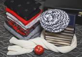 Stack of winter clothes and books with gold edge — Stock Photo