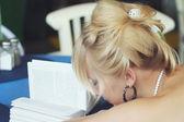 Fallen asleep over a book — Stock Photo