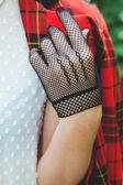 Horsewoman hand in fishnet glove  — Stock Photo