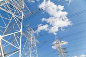 Power transmission lines against blue sky — Stock Photo