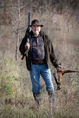 Hunter with a gun and wildfowl — Stock Photo