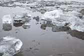 Blocks of ice on a winter frozen river — Stock Photo
