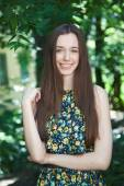 Young beautiful teen girl in summer park — Stock Photo